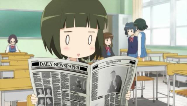Shino reading a newspaper
