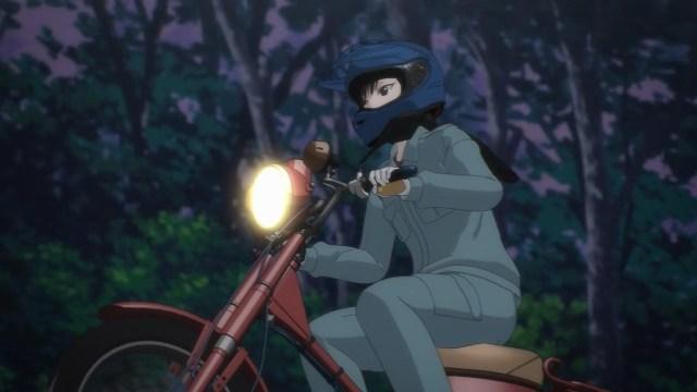 Reiko riding up a mountain trail